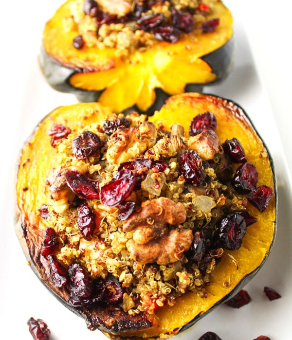 Roasted Acorn Squash With Cranberry Walnut Quinoa Stuffing on the counter.