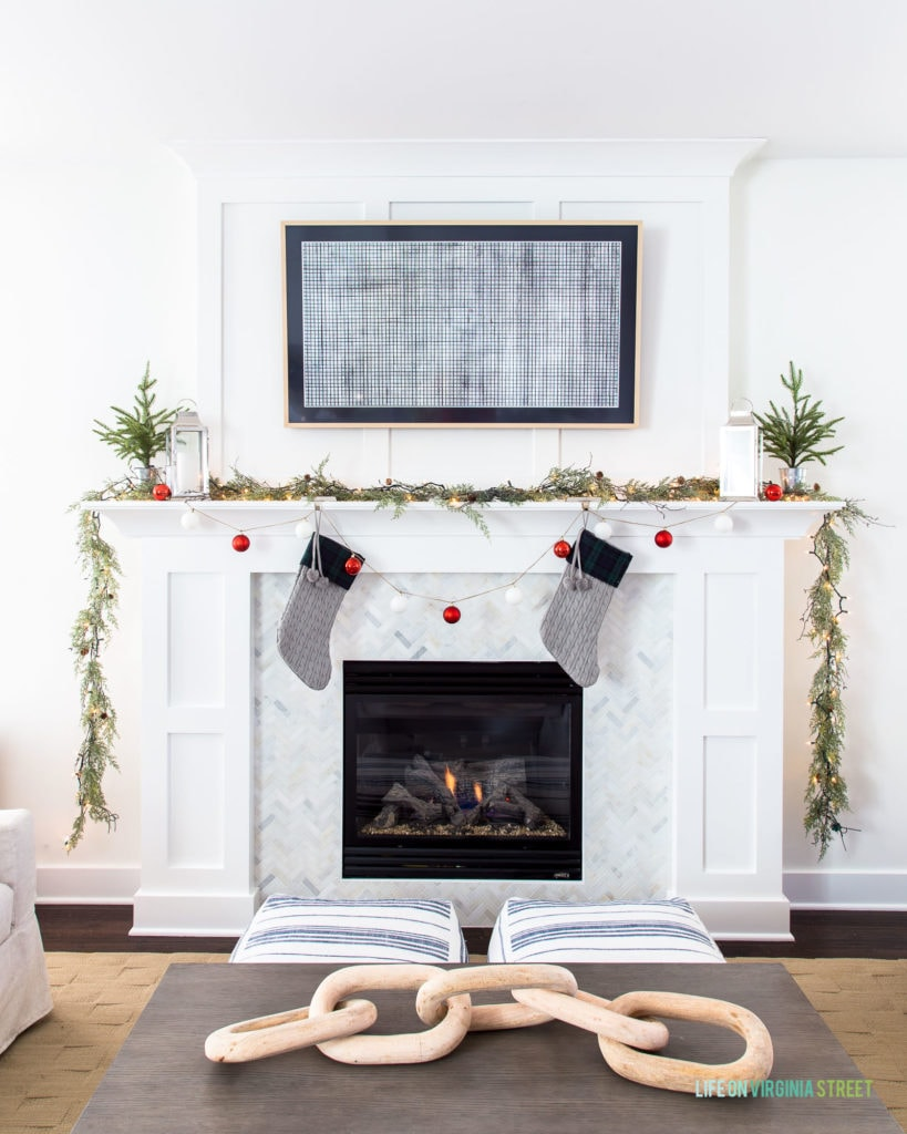 A gorgeous white and marble Christmas mantel along with an easy DIY ornament garland. Full tutorial included!