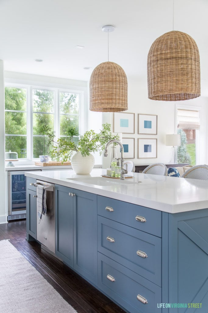A coastal inspired kitchen with a Benjamin Moore Providence Blue island.