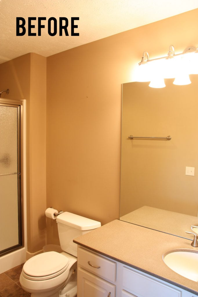 The before photo from a small guest bathroom remodel makeover.