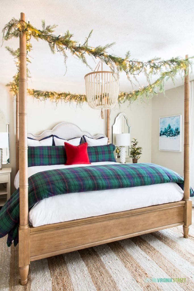 A gorgeous Christmas bedroom. I love the garland and twinkle lights strung from the canopy bed! The navy blue and hunter green plaid bedding are the perfect look for the holidays!