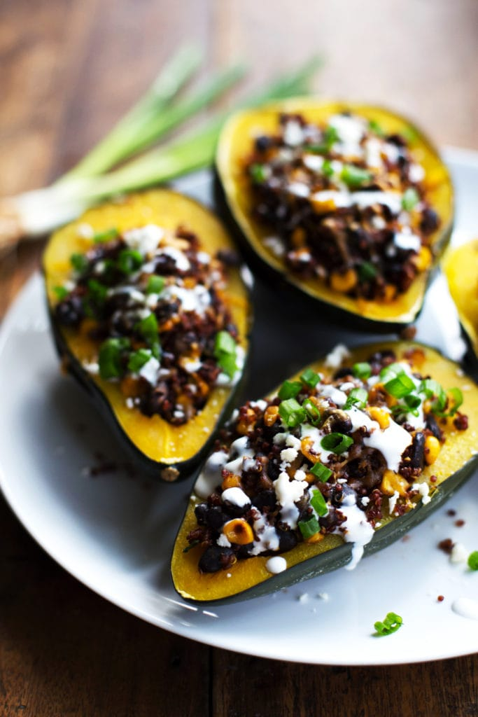 Mexican roasted stuffed squash on a white plate.
