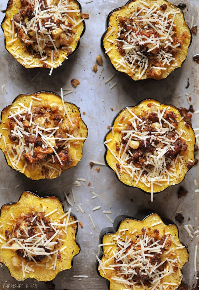Stuffed squash in a scalloped baking individual tins with parmesan on the top.