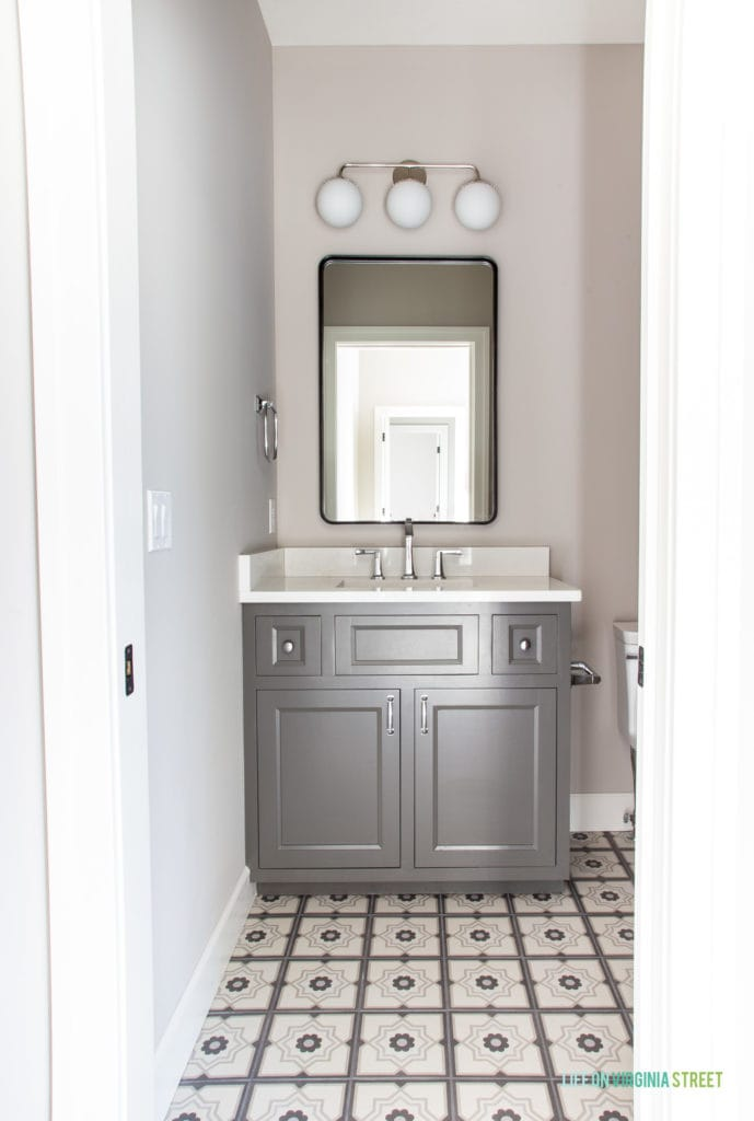 Gray bathroom vanity with patterned tile floors. Cabinet color is Benjamin Moore Kendall Charcoal.