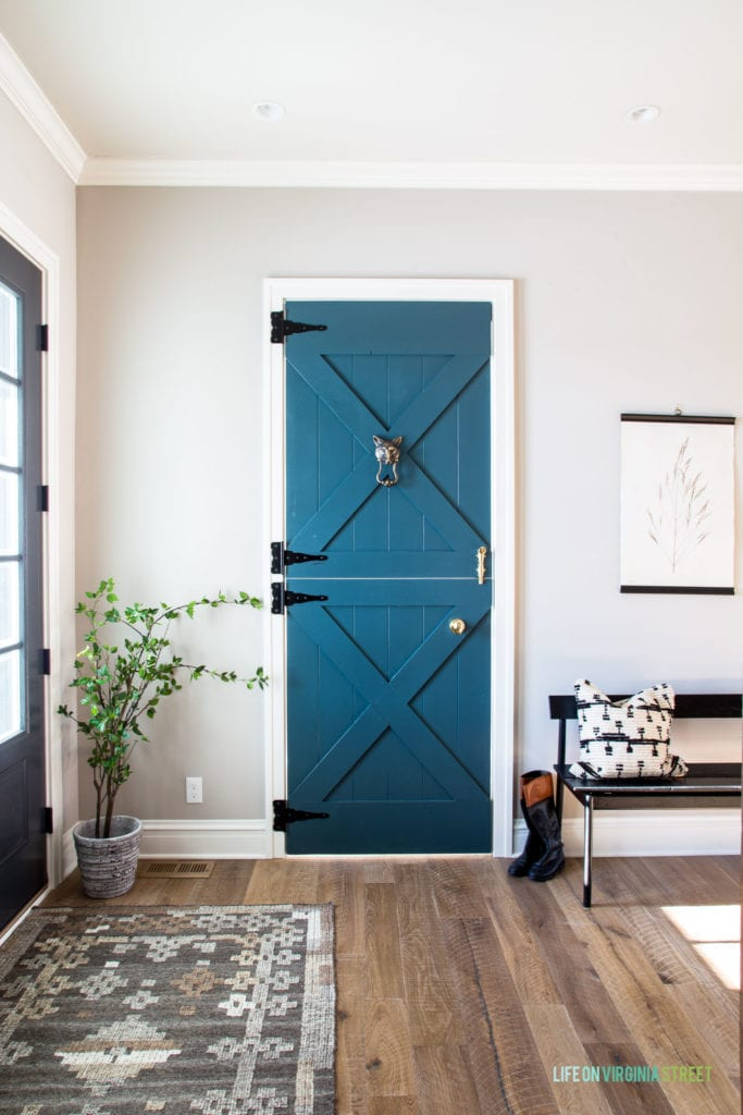 Darling Dutch door leading to a home office. Paint colors is Benjamin Moore Yorktowne Green.