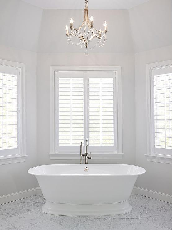 Benjamin Moore Paper White walls in a master bathroom with a free standing tub.