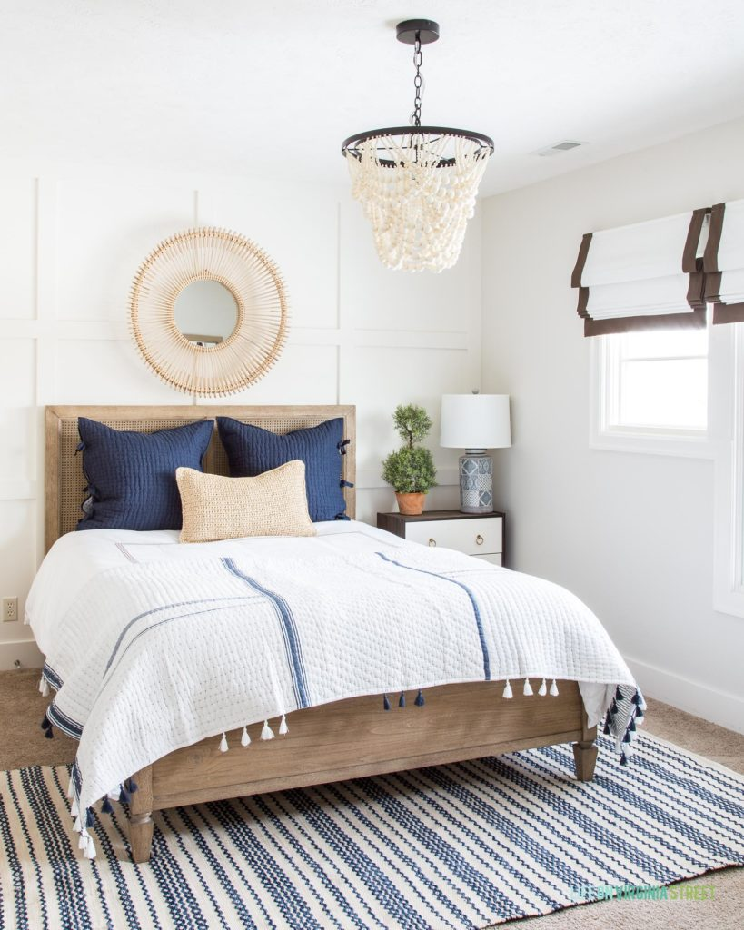 A blue and white bedroom featuring Behr Swiss Coffee on the trim and board and batten and Benjamin Moore Classic Gray on the walls.