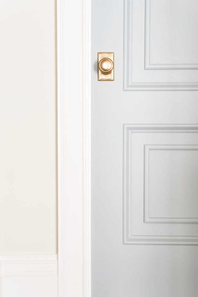 An interior door painted Benjamin Moore Boothbay Gray. I love the gold door hardware paired with this pretty blue gray paint color.