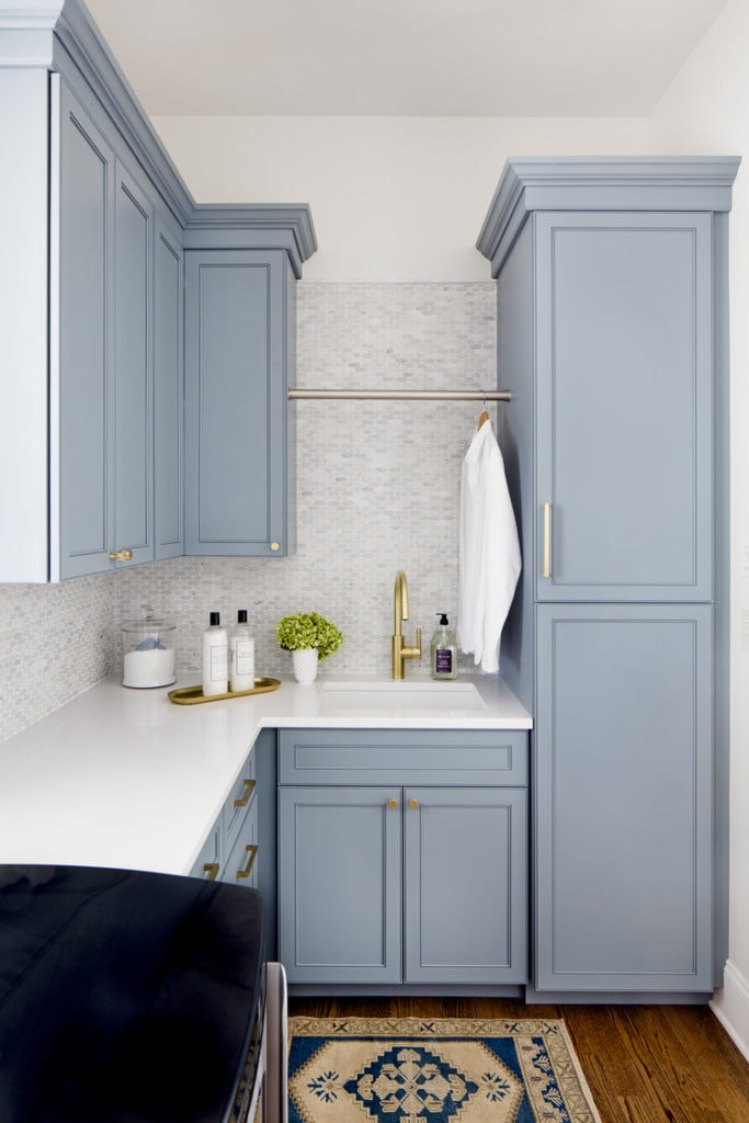 Laundry room cabinets painted in Benjamin Moore Van Courtland Blue. This is a gorgeous blue gray paint color option!