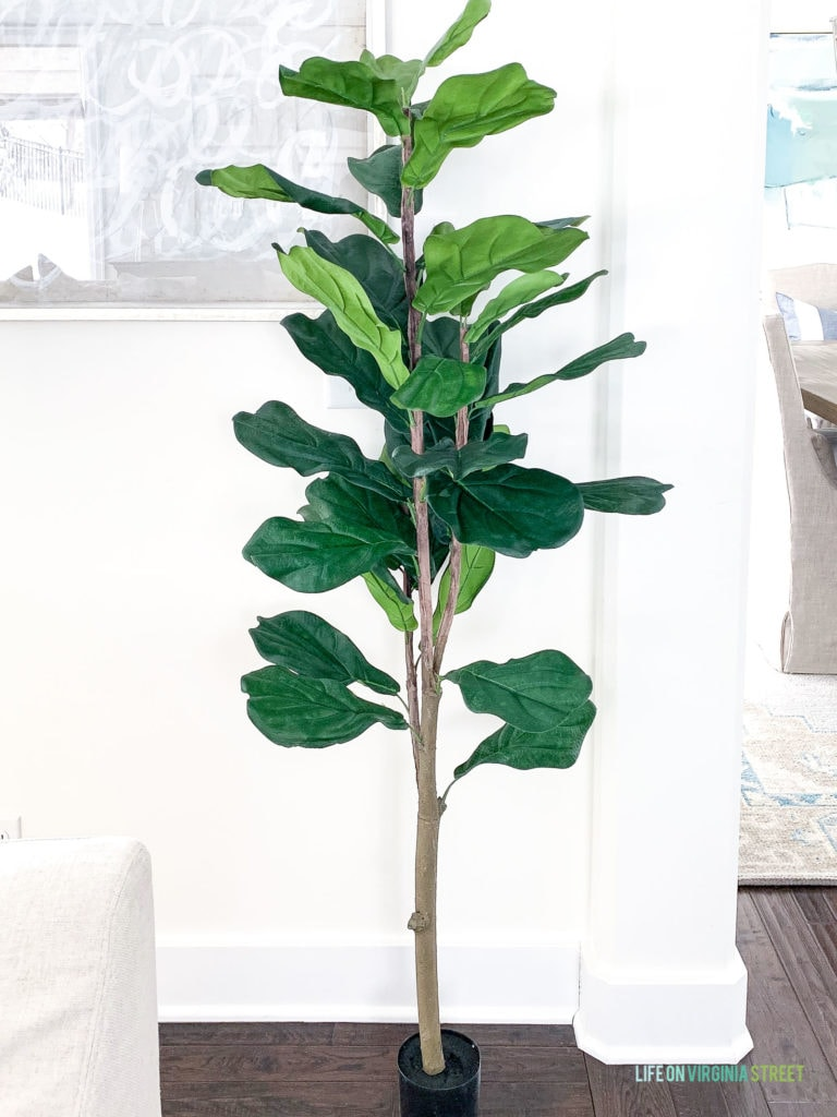 An affordable faux fiddle leaf fig tree. Looks great with the planter pot or basket of your choice!