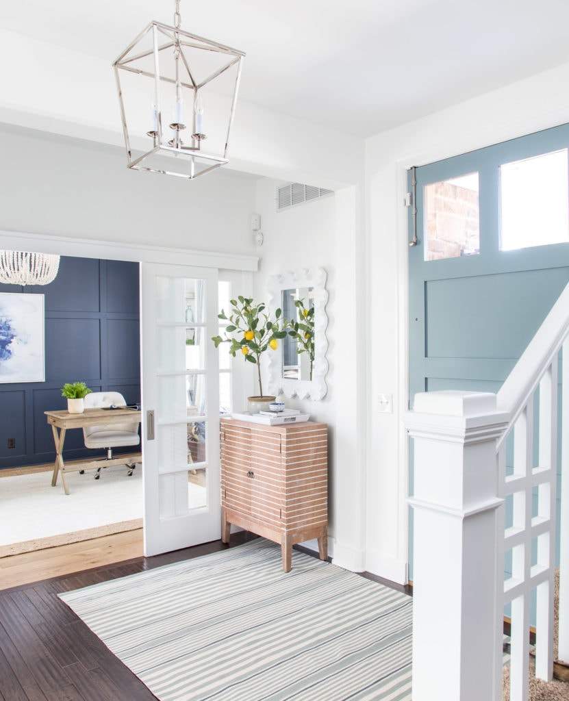 A beautiful spring entryway decorated using blue, greens and neutrals. I love this view looking into the office - painted Benjamin Moore Hale Navy.