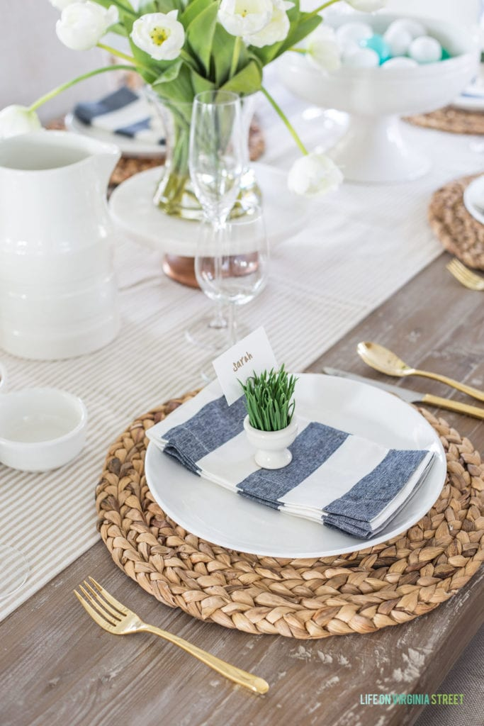 An spring and Easter place setting featuring neutrals mixed with navy blue and green!