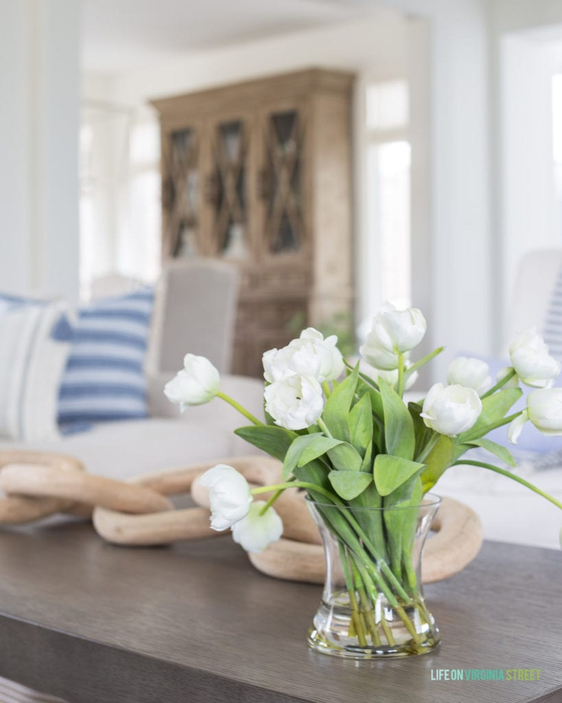 Faux white tulips in a blue and white spring living room.