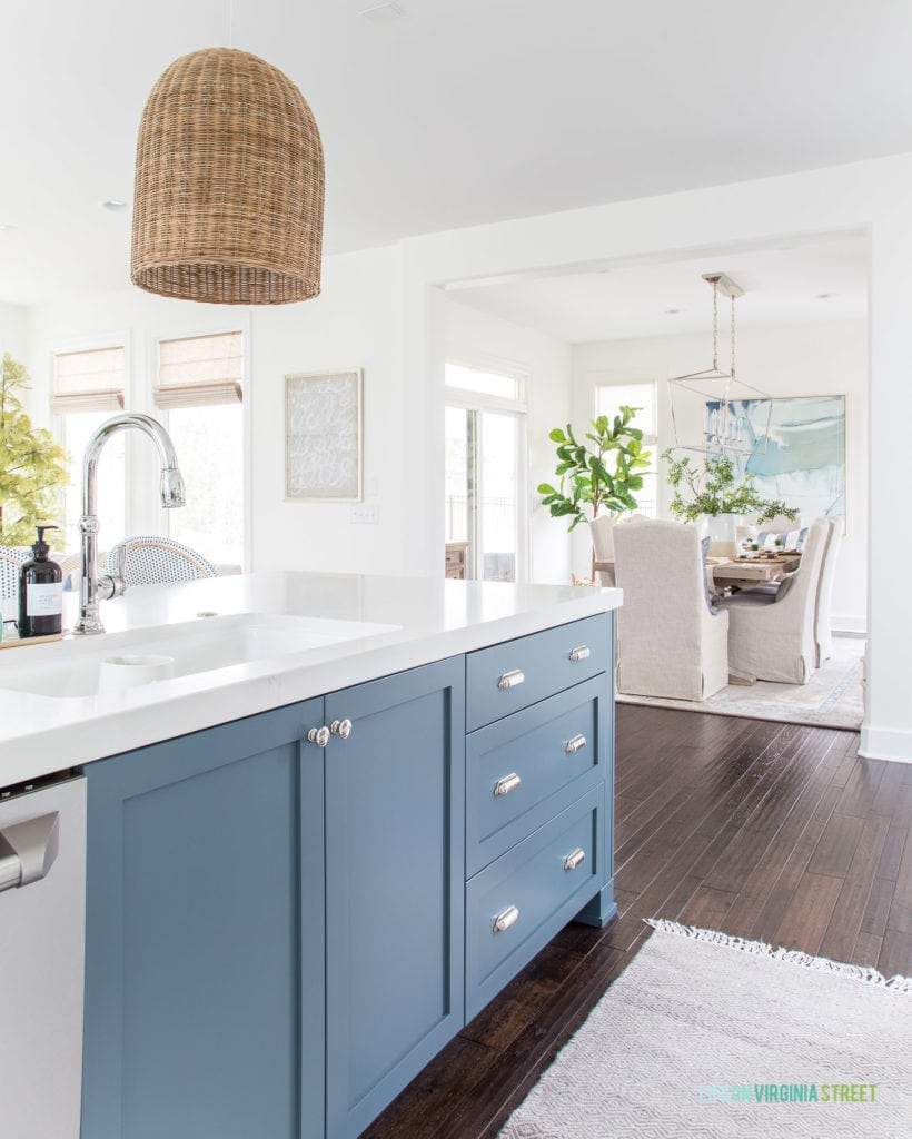 A spring kitchen looking into a blue and white dining room. Love the subtle spring accents!