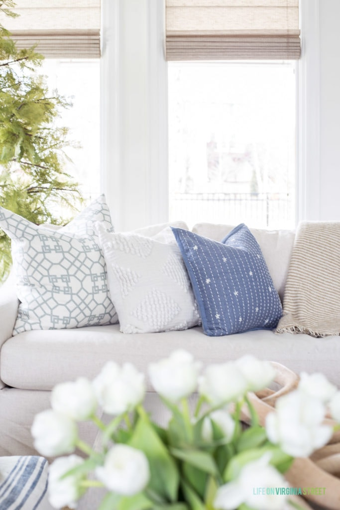 An eclectic pairing of coastal blue and white throw pillows for spring.