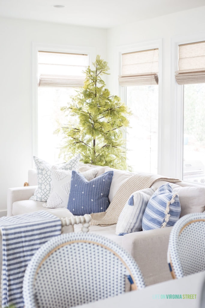 Affordable spring throw pillows from TJ Maxx online. I love the linen sofa paired with the blue and white pillows.