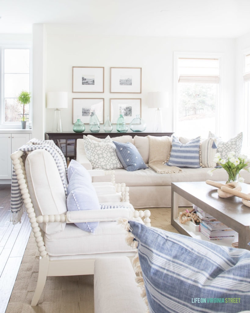 A blue, white, and neutral spring living room. I love all the stripes and pops of green from the botanicals!
