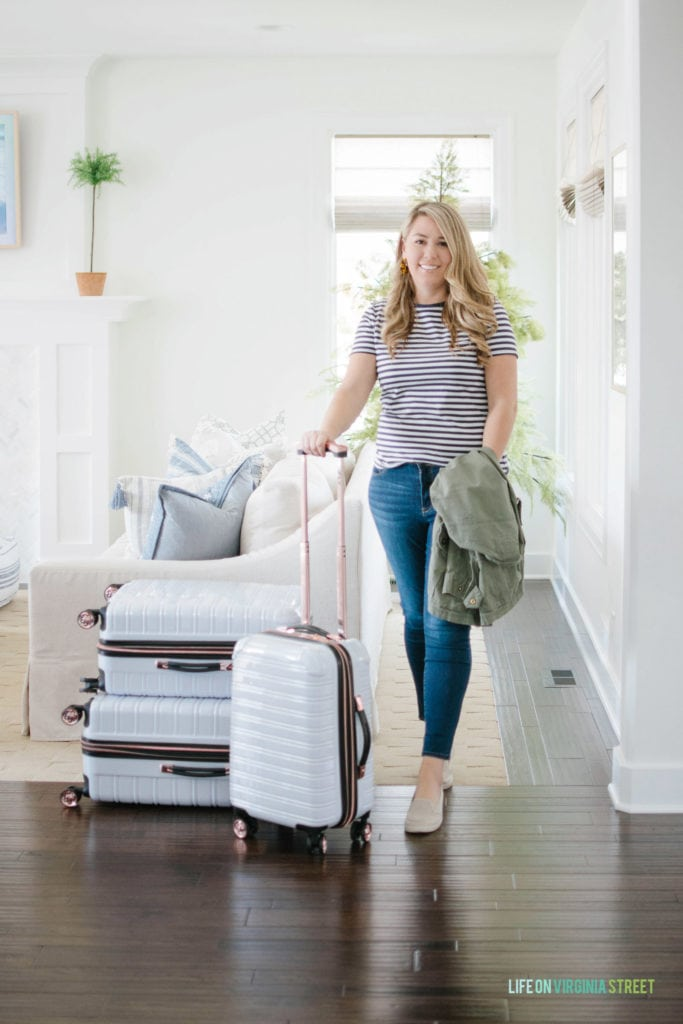 Cute travel day outfit ideas along with tips on how to pack a carry-on suitcase like a pro.