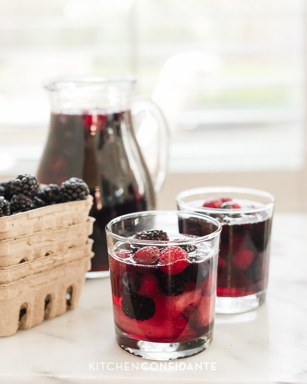 Berry Sangria with blackberries and raspberries in the glass cups.