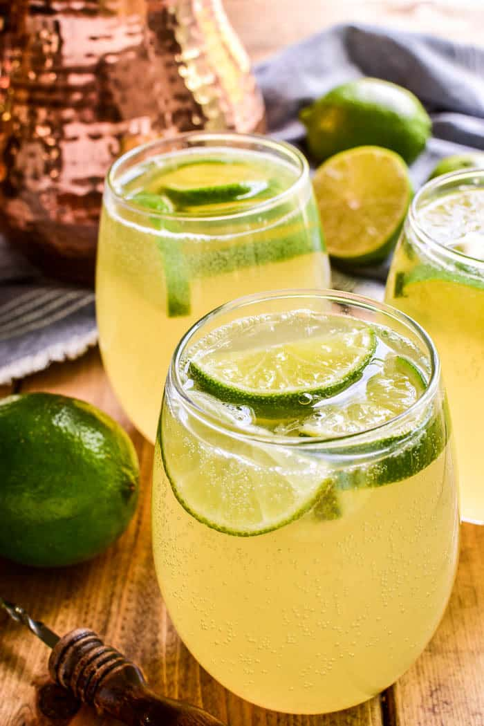 Moscow Mule Sangria with fresh limes in it.