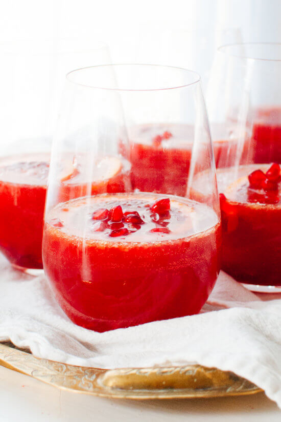 Blood Orange and Pomegranate Sparkling Sangria cups on the table.