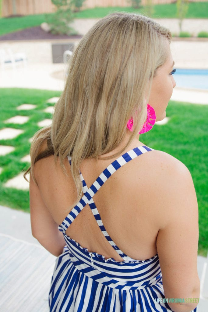 Criss crossed straps on the back of the striped dress.