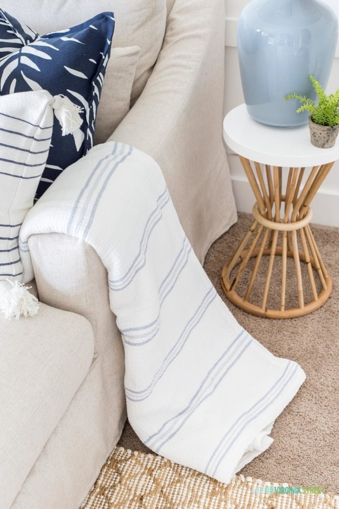 A blue and white striped gauze blanket that is perfect for summer months!