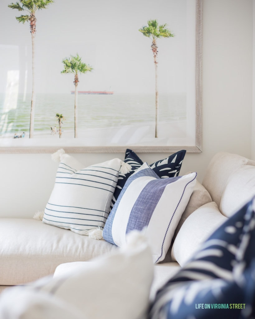 Beautiful Serena & Lily pillows in a blue and white stripe, stripe with tassels, and navy blue and white palm leaf print.