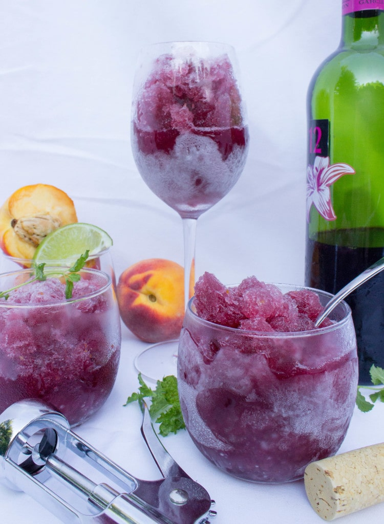 Peach Sangria Granita which has a dark purple slushy in it.