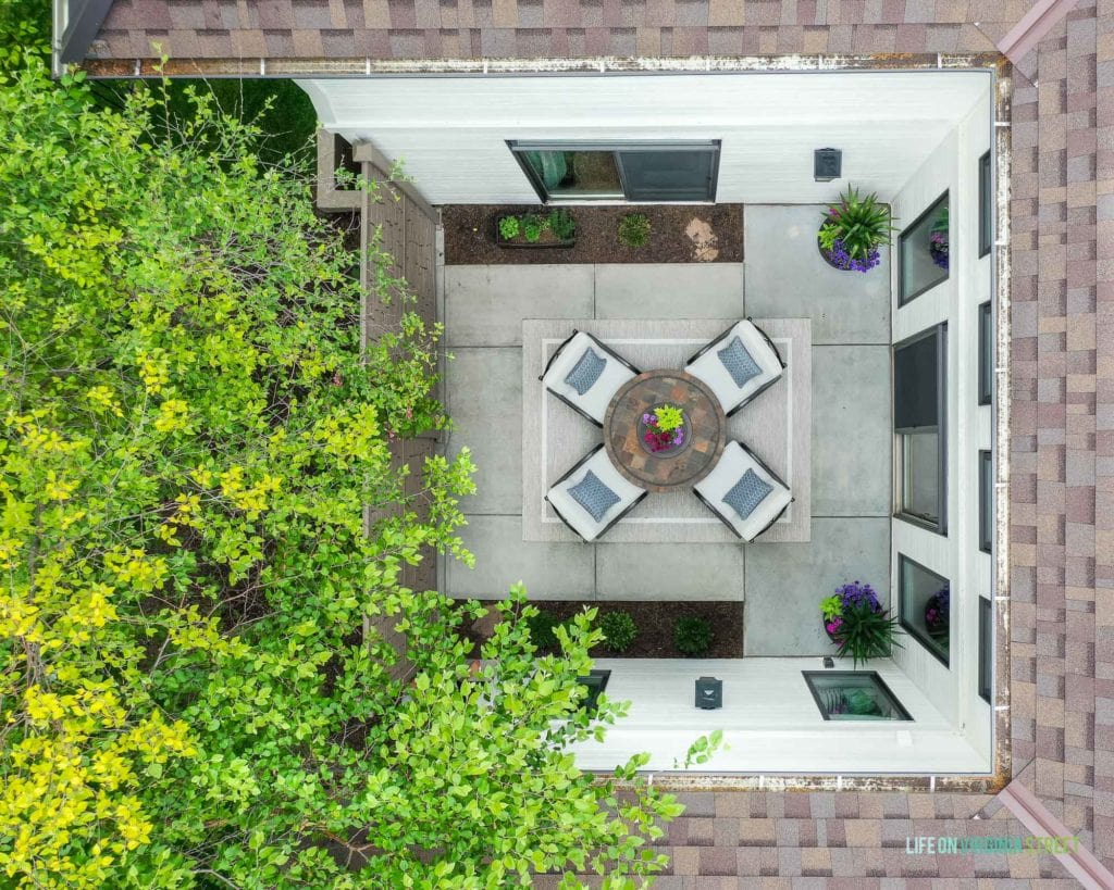 An aerial view of the courtyard looking down onto the small patio with chairs.