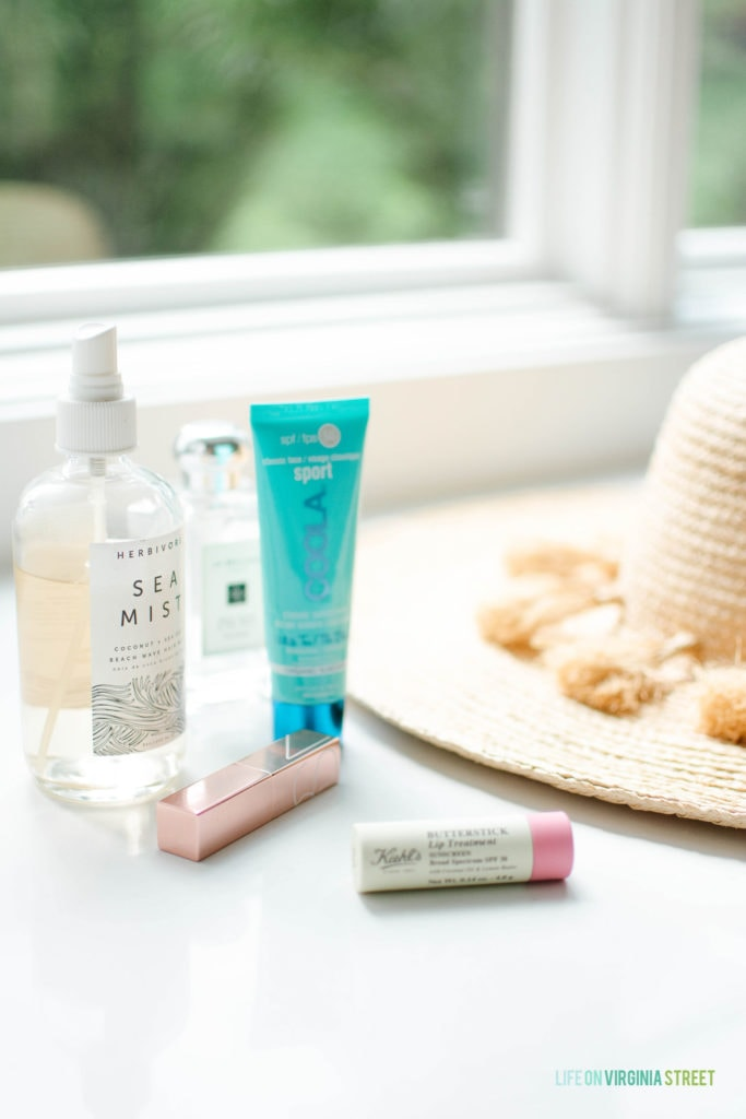A few of my favorite summertime essentials, including a beachy wave hair mist, face sunscreen, SPF lip treatment, raffia hat and more!