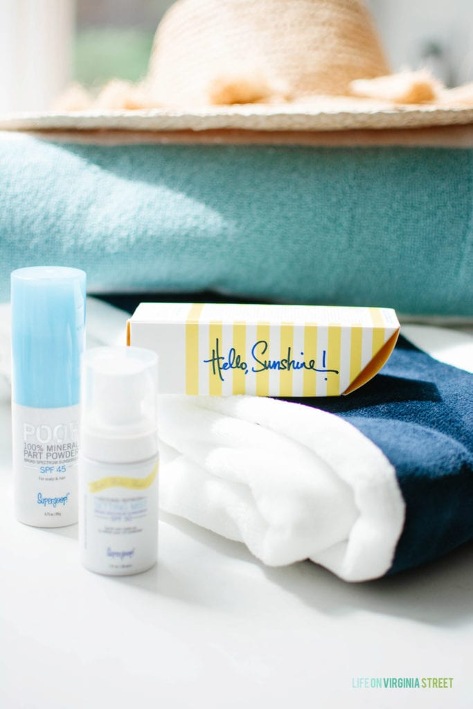 Beauty products by the towel.