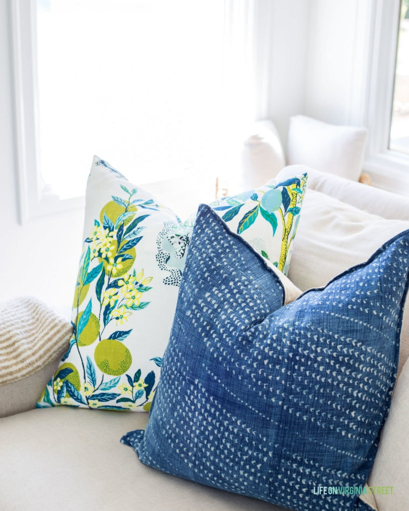 Lemon and citrus pillows paired with these pretty hand-dyed blue pillows make for the perfect summer decor!