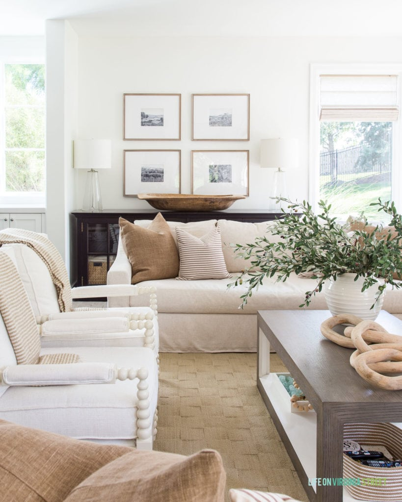 This beautiful brown and bronze living room is part of a neutral fall home tour that makes fall decorating a breeze!