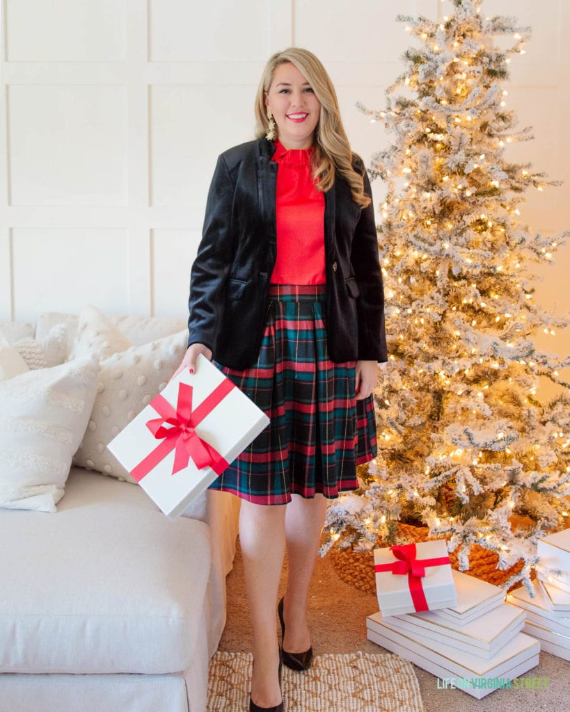 Gibson x Hi Sugarplum Holiday Collection feature a black velvet blazer, red satin top, and a plaid skirt.