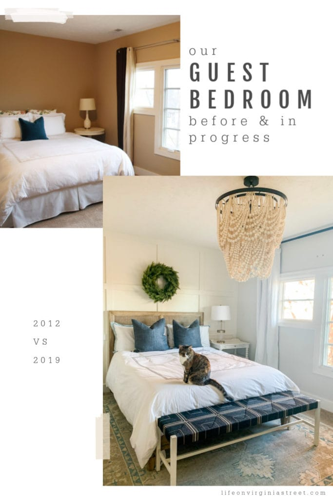 A large white heavy beaded chandelier in the guest bedroom. There is a cat on the bed.
