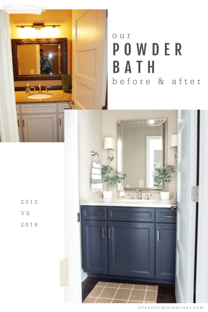 The small powder bathroom with navy blue cabinet and white counters.
