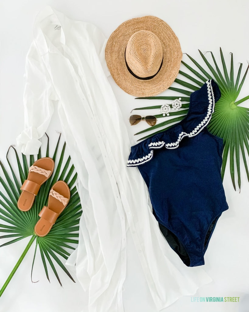 Nevis outfits and ideas on what to pack for a tropical vacation at a resort! I love this long white coverup paired with this navy blue ric rac bathing suit and straw hat!