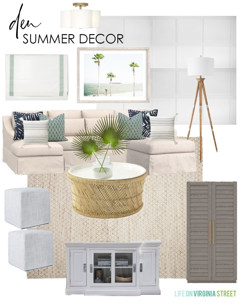 Summer decorating ideas for a den with a linen sectional sofa, bamboo coffee table, shutter storage cabinet, palm tree art, and blue and white pillows.