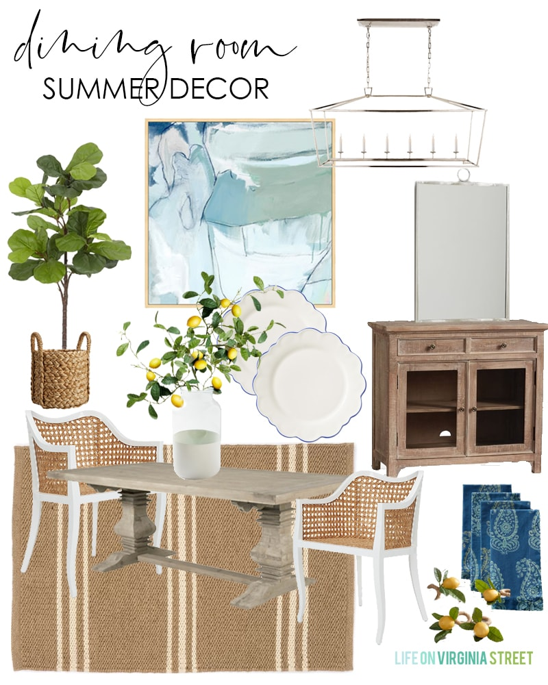 Dining room summer decorating ideas with cane chairs, wood table, striped rug, blue abstract art, faux lemon stems, lemon napkin rings, paisley napkins and a faux fiddle leaf fig tree.