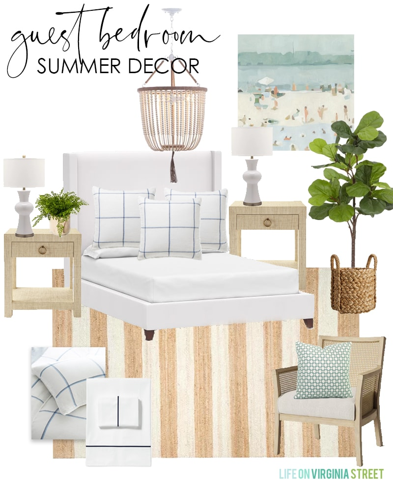 Summer decorating ideas for a guest bedroom with a white upholstered bed, striped jute rug, bead chandelier, and abstract beach art.