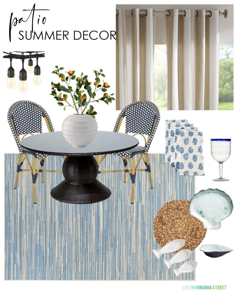 Summer decorating ideas for a patio with a round table, blue rug, striped outdoor curtains, string lights and coastal inspired dinnerware.