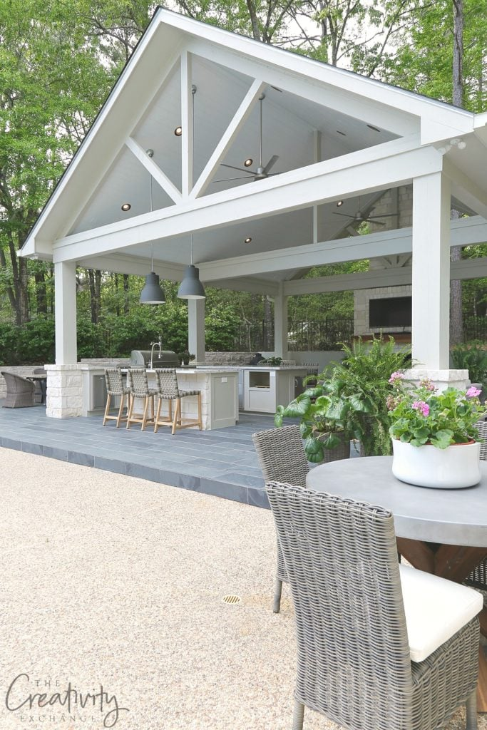A gorgeous pool house and outdoor kitchen area via The Creativity Exchange.