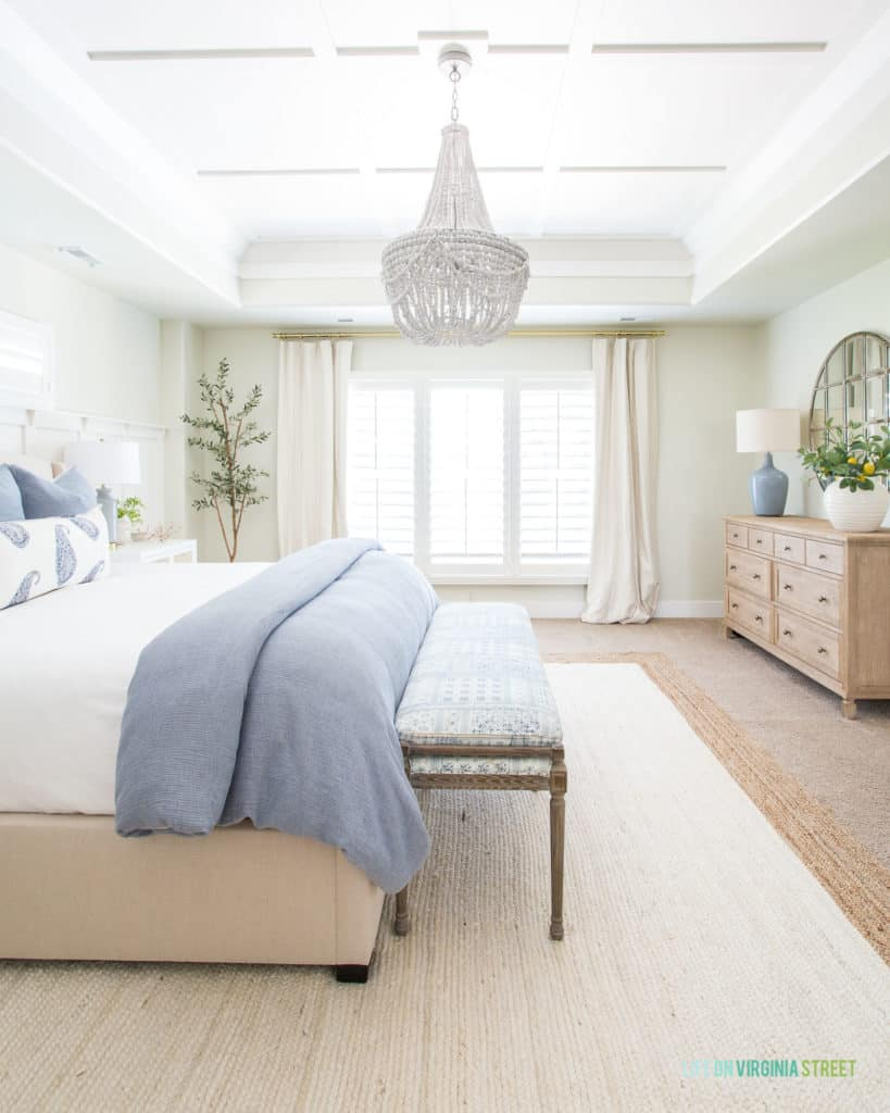 Master bedroom walls painted Valspar September Fog. Trim and ceiling color are Benjamin Moore Simply White.