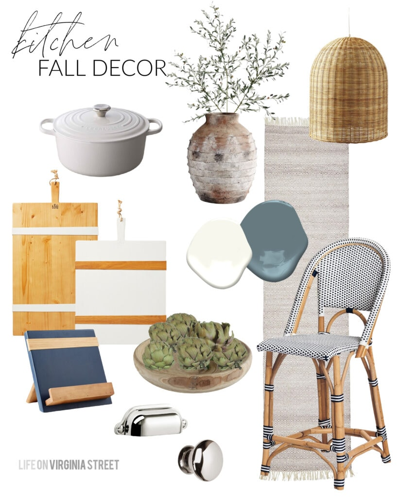 Fall design board for a kitchen with navy blue bistro counter stools, basket pendant lights, wood serving boards, white dutch oven, faux olive stems, and neutral runner rug.
