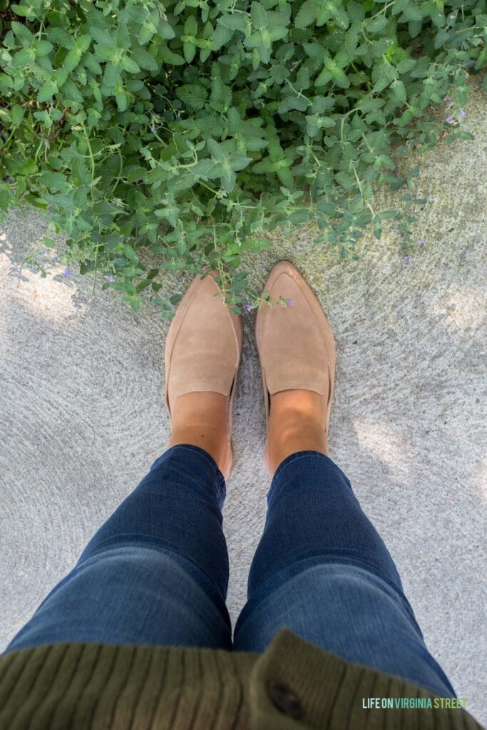 Fall fashion trends including mules, skinny jeans and an oversized cardigan.