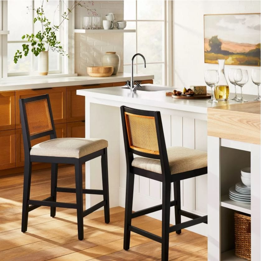 Gorgeous cane barstools from the new Studio McGee fall collection at Target! Styled in a kitchen with a white island and wood cabinets.