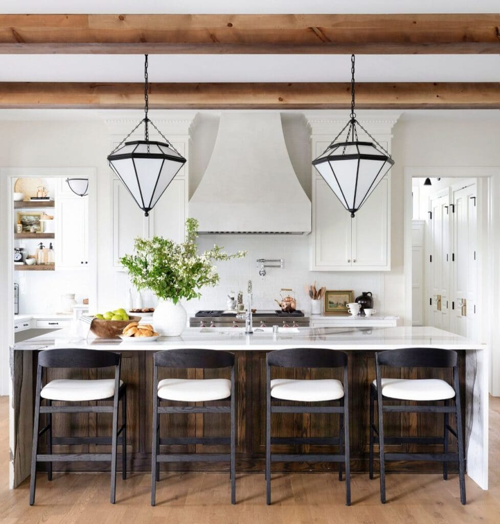 Tudor House Renovation Ideas for the kitchen. Love this walnut tone island with a white kitchen.