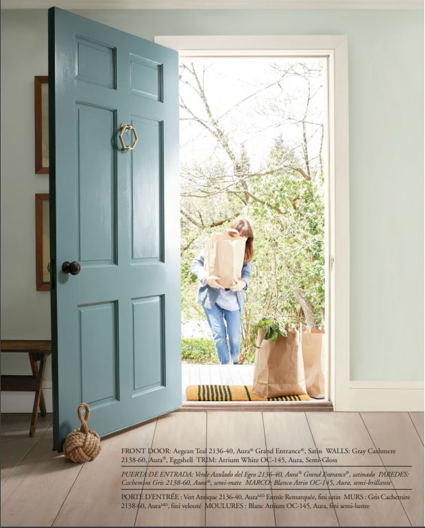 A front door painted Benjamin Moore Aegean Teal, the BM 2021 Color of the Year!