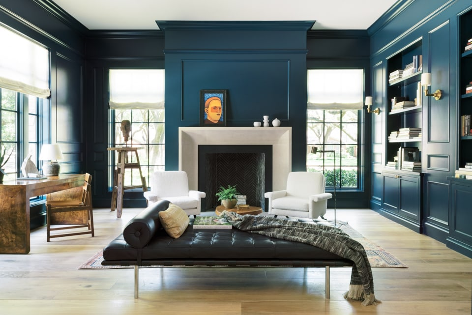 High-gloss Farrow & Ball Hague Blue walls in a moody home library. A perfect dark blue green paint color!